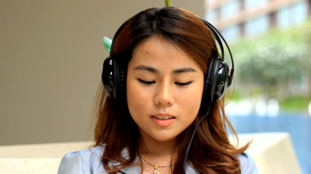 Young woman listening to music and signing relaxing asian woman listen music bluetooth stock videos & royalty-free footage