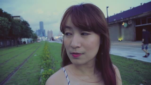 Young woman looking at camera video