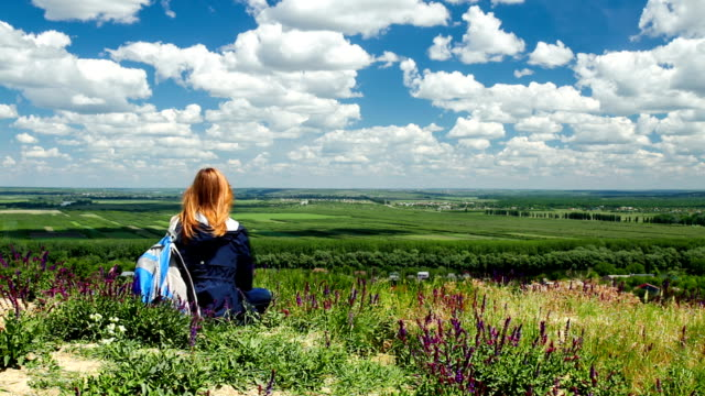 Young woman looking at scenic view of valley video