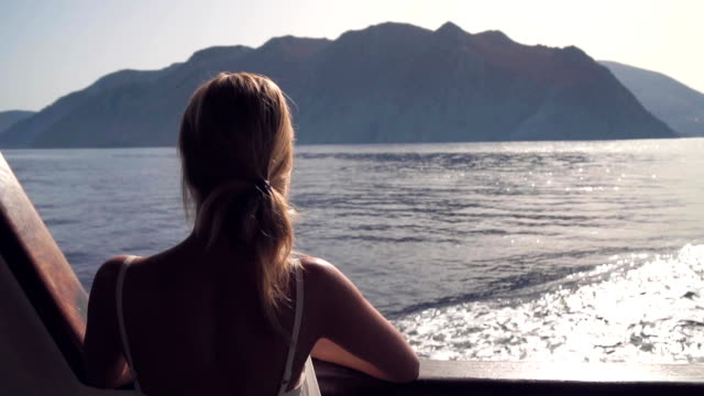 young woman looking at sea from vessel - cruise video stock e b–roll