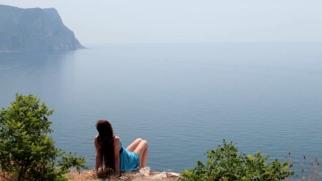 Young woman looking at sea video
