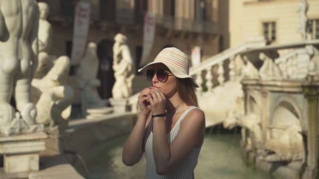 Young woman make a wish on italian fountain in Palermo