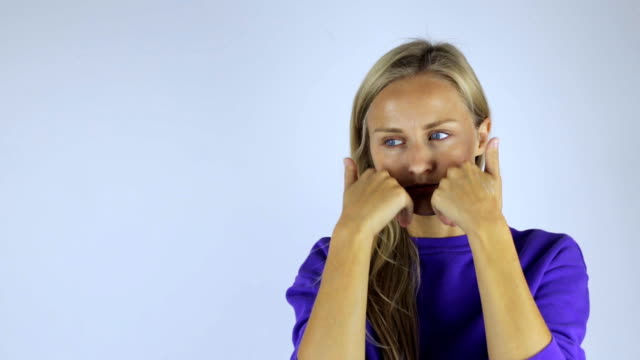 Young woman makes a face massage video
