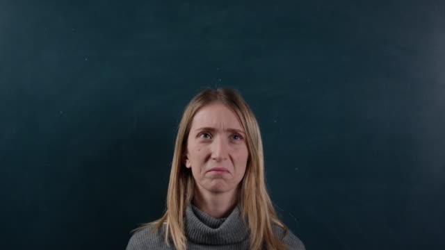Young woman making various facial expressions video