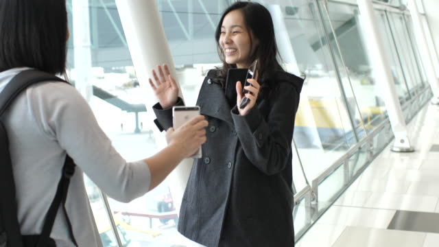 Young woman meet with friend Arriving in the Airport, Embracing video