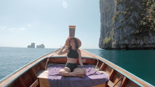 Young woman on a longtail boat in Thailand, Phi Phi Island