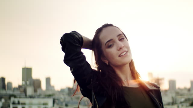 Young woman on a rooftop. Flirting with camera