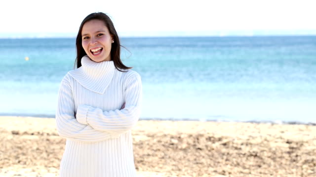 young woman on beach with positive face expressions video