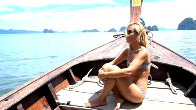 Young woman on boat adventure video