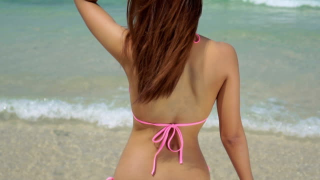 Young woman on the beach video
