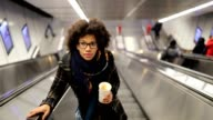 istock Young woman on the escalator 1086530822
