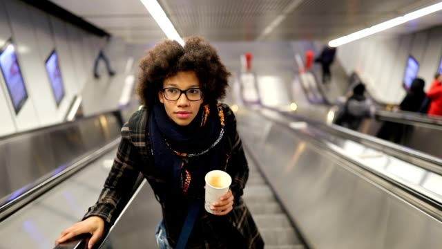 young woman on the escalator - escalator video stock e b–roll