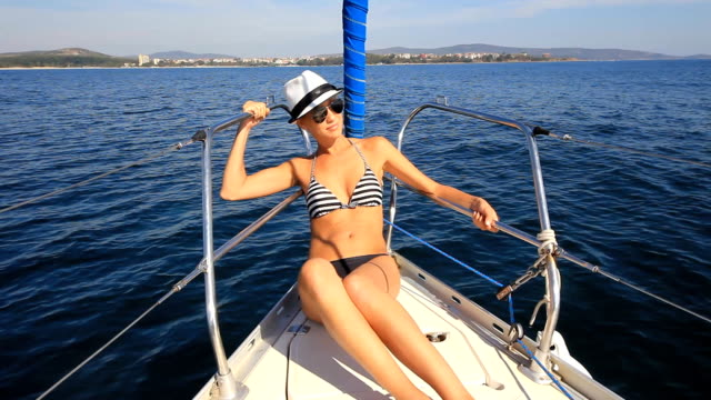 Young woman on the yacht video