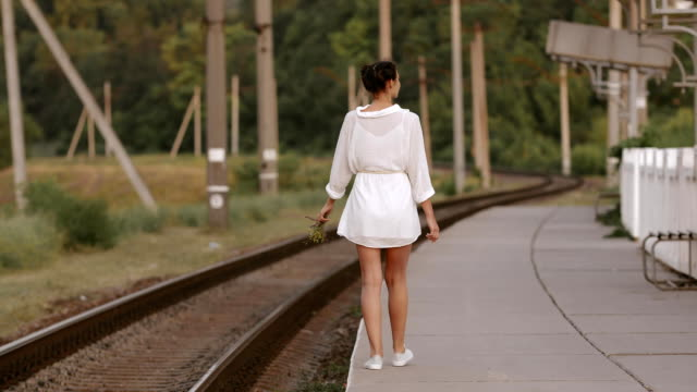 Young woman on train station