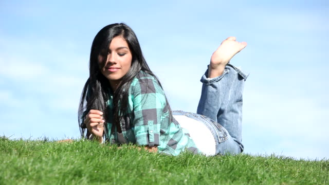 Young woman outdoors in grass video