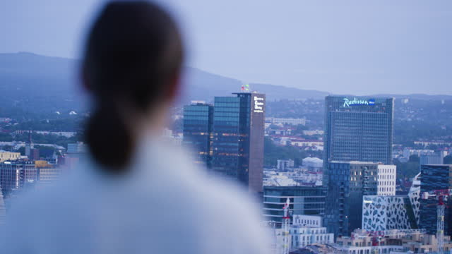 Young woman overlooking Oslo, Norway. Shot of woman overlooking Oslo. rack focus stock videos & royalty-free footage
