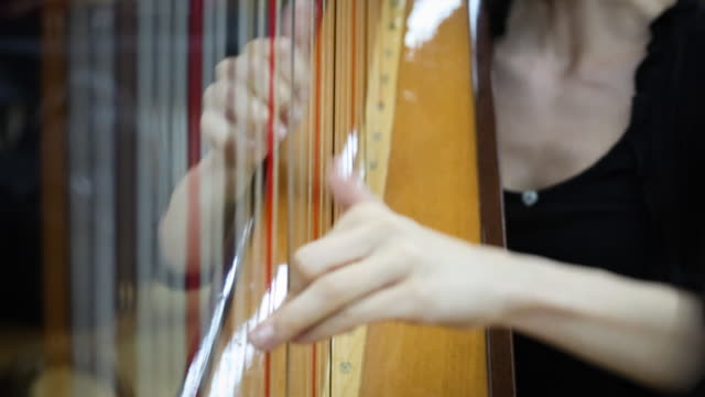 young woman playing harp