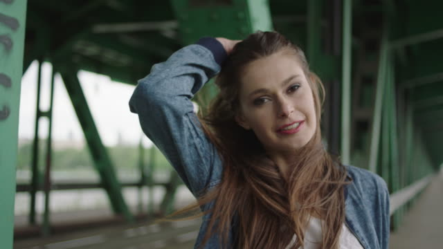 Young woman posing under the bridge video
