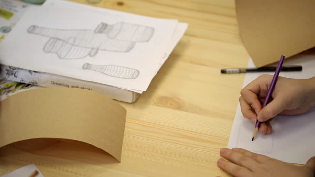 Young woman practices in drawing three-dimensional figures in art studio video