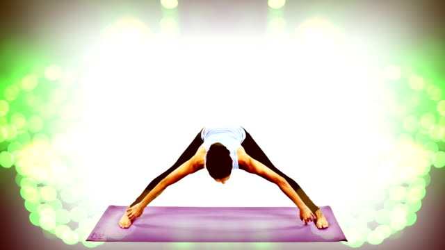 young woman practices yoga video