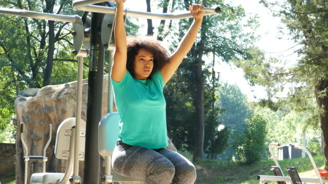 Young woman practicing in park video