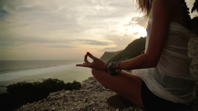Young woman practicing yoga on the beach. video