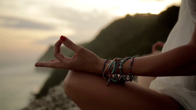 Young woman practicing yoga on the beach. Young woman practicing yoga on the beach. mindfulness stock videos & royalty-free footage