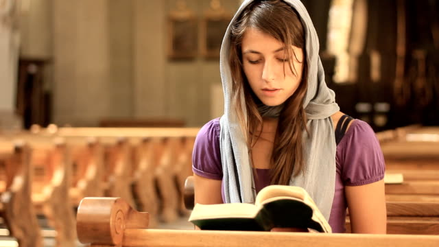 Young woman praying video
