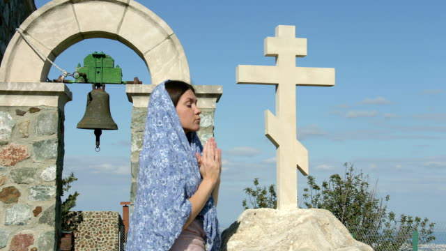 Young woman praying with clasped hands, begging God for blessing video