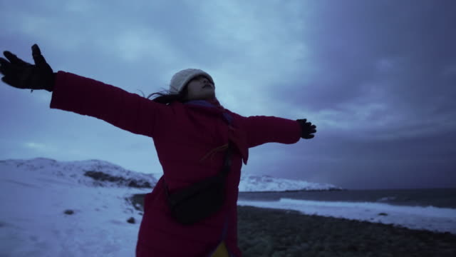 Young woman raised her arms and feeling free in winter