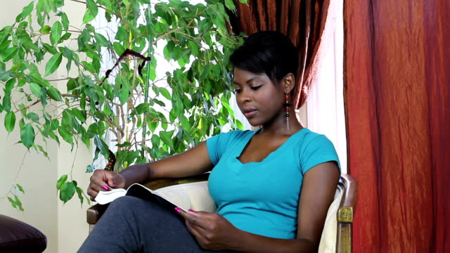 Young woman reading a book. video