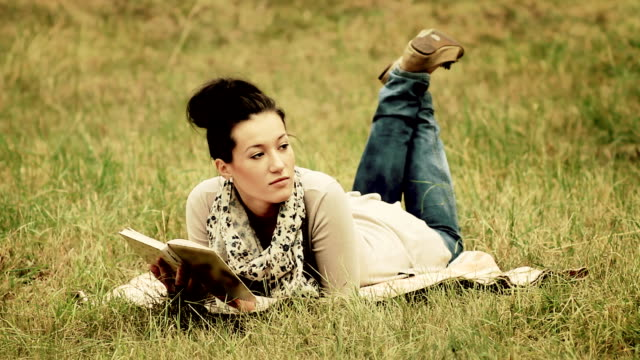 Young woman reading on nature. video