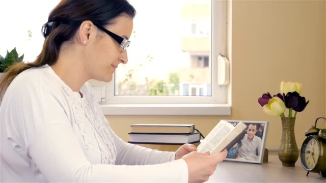 Young woman reading the Bible and begins to pray video