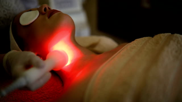 young woman receiving laser treatment - facial stock videos & royalty-free footage
