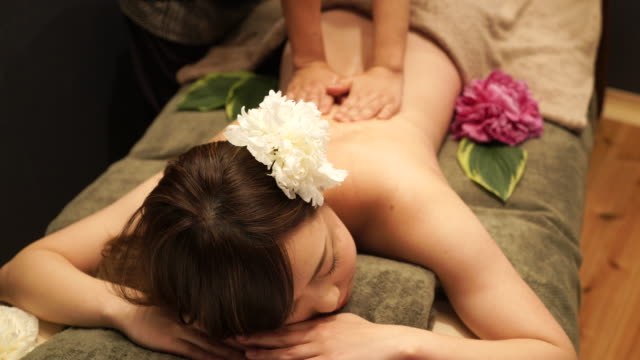 Young woman receiving oil massage Young woman enjoy massage at spa spa treatment stock videos & royalty-free footage