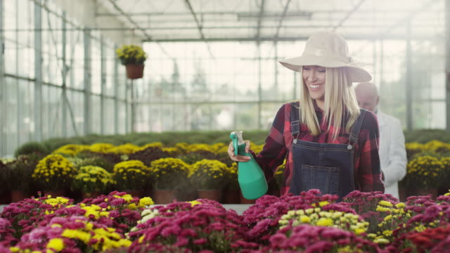 Young woman refreshing plants video