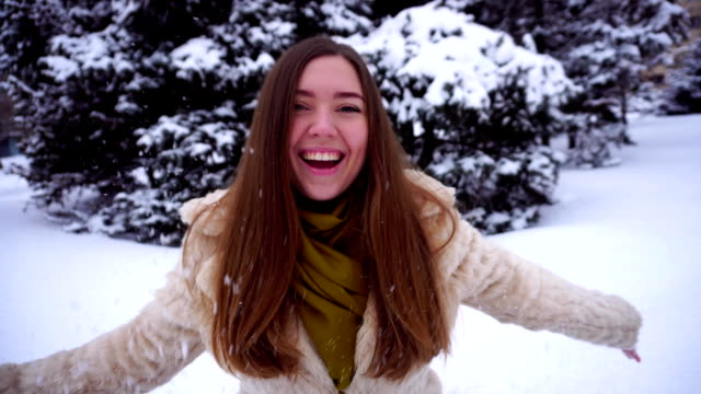 Young woman rejoicing at first day of winter video