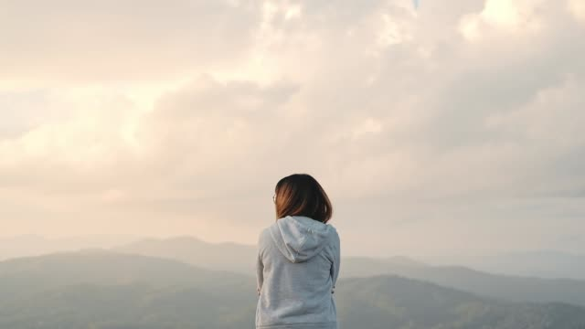 Young woman relaxation and freedom on Top Mountain