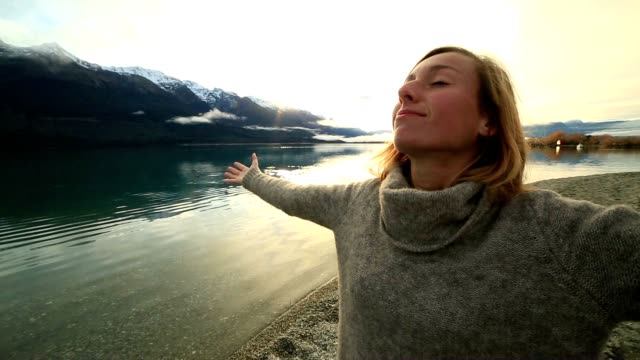 young woman relaxes by the lake in autumn - alternative medicine stock videos and b-roll footage