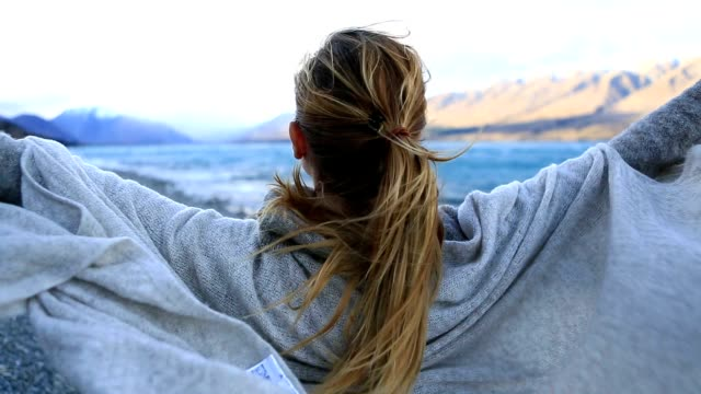 young woman relaxing by the lake - alternative medicine stock videos and b-roll footage
