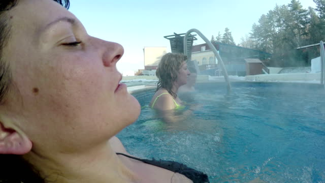 Young woman relaxing in thermal pool video