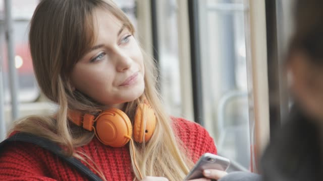 young woman riding in public transportation - tranvia video stock e b–roll