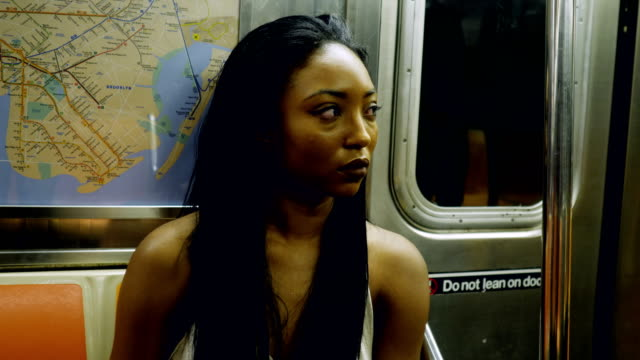Young Woman Riding the New York City Subway Young Woman Riding the New York City Subway Concept series subway station stock videos & royalty-free footage