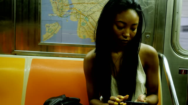 Young Woman Riding the New York City Subway Young Woman Riding the New York City Subway Concept series new york city subway stock videos & royalty-free footage