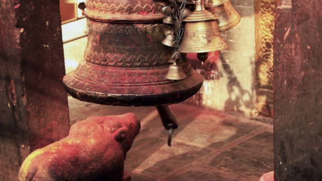 Young woman rings a temple bell video