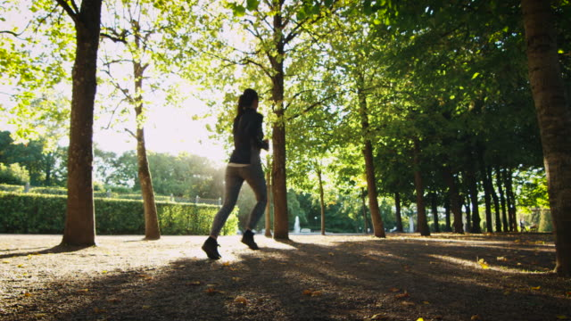 Young Woman Running Forward Outwards Camera in Bright Sunny Day video