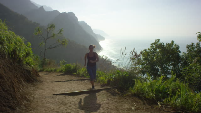 Young woman running on a trail video