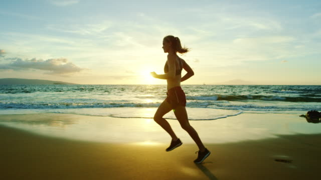Young Woman Running on Beach video