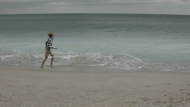 Young woman running on the beach in the Black Sea. video