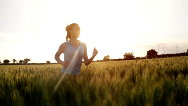 Young Woman Running Wheat Field Sunset Slow Motion video